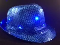 Blue Sequin Fedora Hat with 10 Blinking Blue LEDs. Lights blink in 3 different patterns. Be the coolest person at your event with this awesome blinking sequin hat. One size fits most - up to 22 inches. Discounts for purchases of 10 or more. Email us for pricing.