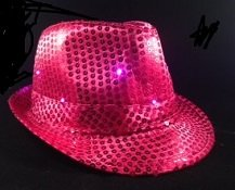 Pink Sequin Fedora Hat with 10 Blinking Pink LEDs. Lights blink in 3 different patterns. Be the coolest person at your event with this awesome blinking sequin hat. One size fits most - up to 22 inches. Discounts for purchases of 10 or more. Email us for pricing.