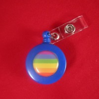"This retractable Rainbow Badge Holder has a 1.25 inch rainbow striped circle on it. Each badge holder has a metal belt clip on the back so you can easily clip on belt or other objects. The cord extends 20"" with automatic retraction. A metal snap holds the badge in place."